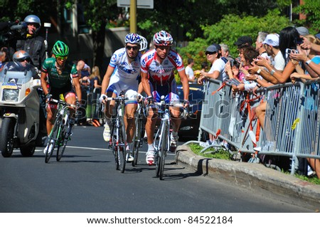 MONTREAL, CANADA-SEPTEMBER 11: An unidentified group of cyclists in action  in 2011 UCI cycling calendar | 2011 Grand Prix Cycliste de Montréal on September 11, 2011 in Montreal, Mount royal climb - stock photo