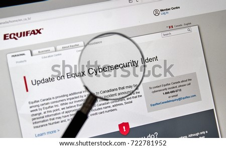 MONTREAL, CANADA - SEPTEMBER, 25 : Equifax Canada home page with information about cybersecurity incident under magnifying glass. Equifax Inc. is a consumer credit reporting agency. Selective focus.