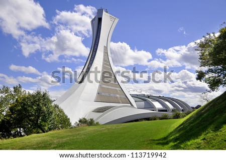 MONTREAL,CANADA -SEPTEMBER 23. The Montreal Olympic Stadium tower on 23, 09, 2012. It's the tallest inclined tower in the world.Tour Olympique stands 175 meters tall and at a 45-degree angle - stock photo