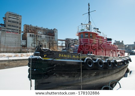 MONTREAL - FEBRUARY 16:The Daniel McAllister in winter in the Old Port of Montreal on February 16th, 2014. It is the largest preserved tug in Canada and the second-oldest oceangoing tug in the world.