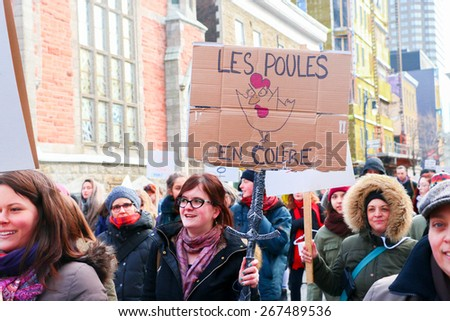 MONTREAL - MARCH 29: A woman holds a sign during a pro-choice rally in Montreal, organized by women's rights groups who oppose to Bill 20, which would limit access to abortions. - stock photo