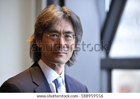 MONTREAL - MAY 4: A portrait of the American conductor and opera administrator Kent Nagano is made during a press conference, on May 4, 2011 in Montreal, Quebec, Canada. - stock photo