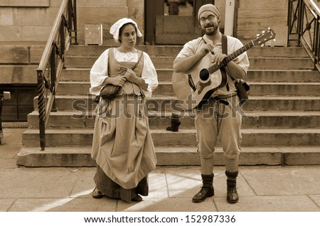 MONTREAL QUEBEC CANADA AUGUST 24: Couple re-enacting New France period in Old Montreal, Pointe-a-Calliere's 18th Century Public Market on august 24 2013 in Montreal Canada - stock photo