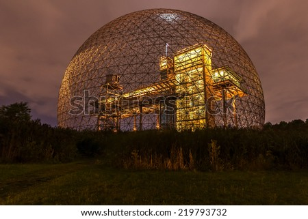 Montreal,Quebec,Canada-August 22-2012 Metallic Structure of Biosphere of Montreal This structure was in 1967 the Pavilion from the United States has the Montreal International Exhibition Yellow. - stock photo