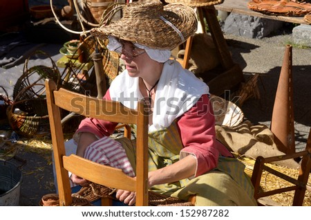 MONTREAL QUEBEC CANADA AUGUST 24: Woman re-enacting New France era in Old Montreal, Pointe-a-Calliere's 18th Century Public Market on august 24 2013 in Montreal Canada - stock photo