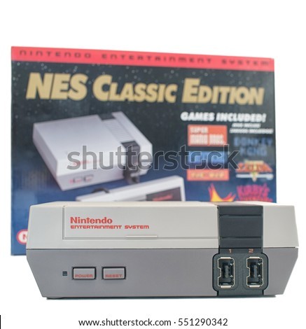 MONTREAL, QUEBEC, CANADA - JANUARY 8,2017: NES Nintendo Classic mini edition console with its box in background. NES mini was one of the most popular Christmas gifts in 2016.