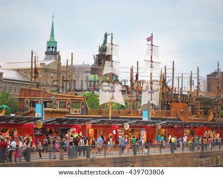 Montreal Quebec Canada  25 July 2015 Old port waterfront family summer fun . Children climbing rope ancient ship theme park with tourist shopping