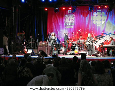 Montreal Quebec Canada - June 26 2015 Diana Fuchs female rock blues vocalist from US in performance on stage with her band at International Jazz Festival .  - stock photo