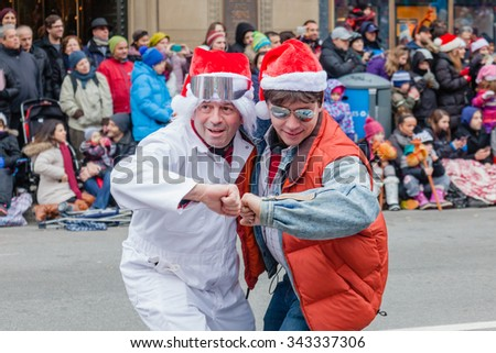 MONTREAL, QUEBEC, CANADA - NOVEMBER 21, 2015 : Marty McFly and Doc Brown  in the 65th edition of the Santa Claus Parade Destination Centre-ville (Defile du Pere Noel) along Saint Catherine Street. - stock photo