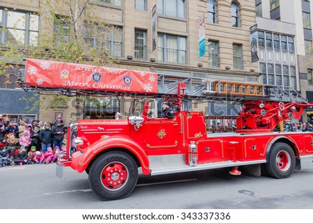 MONTREAL, QUEBEC, CANADA - NOVEMBER 21, 2015 : Old retro fire truck in the 65th edition of the Santa Claus Parade Destination Centre-ville (Defile du Pere Noel) along Saint Catherine Street. - stock photo