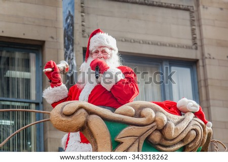 MONTREAL, QUEBEC, CANADA - NOVEMBER 21, 2015 : Santa Claus at the 65th edition of the Santa Claus Parade Destination Centre-ville (Defile du Pere Noel) along Saint Catherine Street. - stock photo