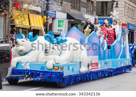 MONTREAL, QUEBEC, CANADA - NOVEMBER 21, 2015 : Singer Michael Girard platform in the 65th edition of the Santa Claus Parade Destination Centre-ville (Defile du Pere Noel) along Saint Catherine Street. - stock photo