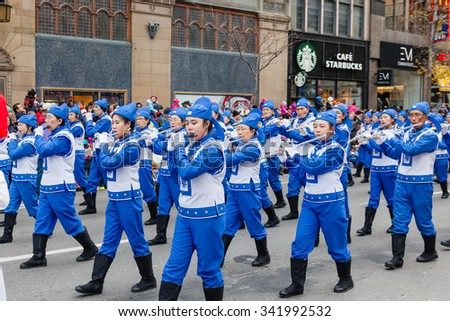 MONTREAL, QUEBEC, CANADA - NOVEMBER 21, 2015 : Tianguo Marching Band Fa Lun Da Fa on 65th edition of the Santa Claus Parade Destination Centre-ville (Defile du Pere Noel) along Saint Catherine Street.