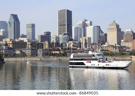 Montreal skyline and boat cruise on Saint Lawrence River, Quebec, Canada - stock photo