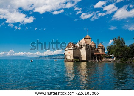 MONTREUX, SWITZERLAND - AUGUST 8: Chillon Castle (Chateau de Chillon) and lake Geneva, Montreux, Switzerland, August 8, 2014. Popular attraction among tourists. - stock photo