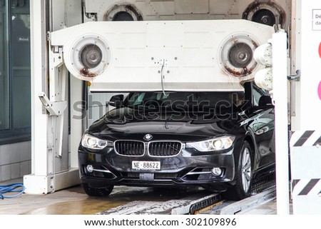 MONTREUX, SWITZERLAND - AUGUST 6, 2014: Motor car BMW F30 3-series at the car wash service station. - stock photo