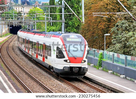 MONTREUX, SWITZERLAND - AUGUST 6, 2014: White and red swiss short distance passenger train SBB-CFF-FFS RABDe 500 at the railway. - stock photo