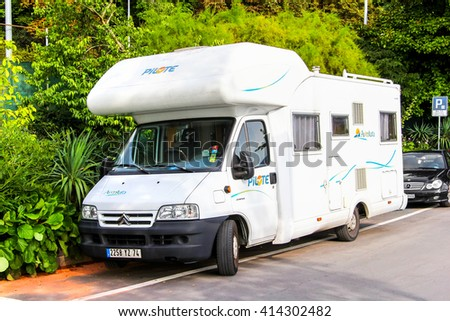 MONTREUX, SWITZERLAND - AUGUST 6, 2014: White campervan Aventura Pilote (Citroen Jumper) in the city street. - stock photo