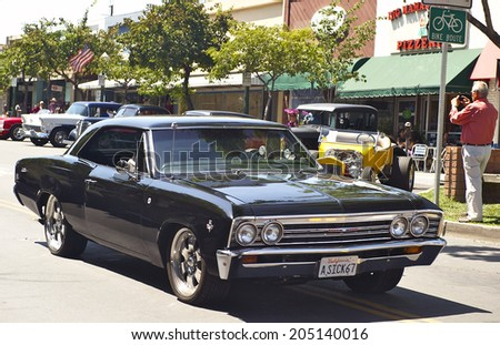 MONTROSE/CALIFORNIA - JULY 6, 2014: Classic 1967 Chevelle as it departs the Montrose Hot Rod & Classic Car Show. July 6, 2014 Montrose, California USA - stock photo