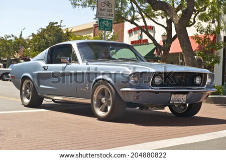 MONTROSE, CALIFORNIA - JULY 6, 2014: Classic Mercury Ford Mustang Fastback as it departs the Montrose Hot Rod & Classic Car Show. July 6, 2014 Montrose, California USA - stock photo