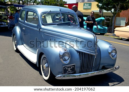 MONTROSE/CALIFORNIA - JULY 6, 2014: 1939 Ford Sedan Deluxe owned by Rex Jaramillo at the Montrose Hot Rod & Classic Car Show. July 6, 2014 Montrose, California USA - stock photo