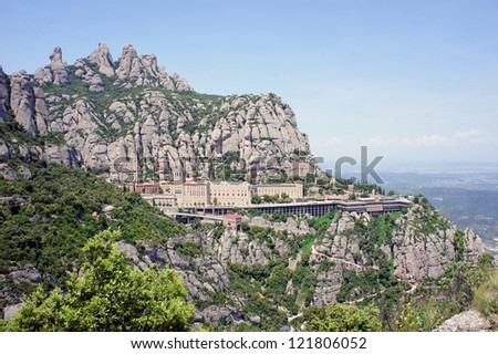 Montserrat Monastery is a beautiful Benedictine Abbey high up in the mountains near Barcelona, Catalonia, Spain. - stock photo