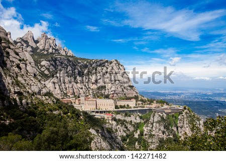 Montserrat Monastery is a spectacularly beautiful Benedictine Abbey high up in the mountains near Barcelona, Catalonia, Spain - stock photo