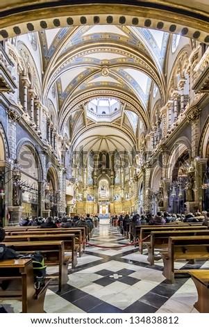 MONTSERRAT SPAIN - JAN 21: Interior of Basilica in Benedictine Abbey of Santa Maria de Montserrat (founded in 1025) on January 21 2013 in Montserrat, Spain. Millions of pilgrims visit abbey every year - stock photo