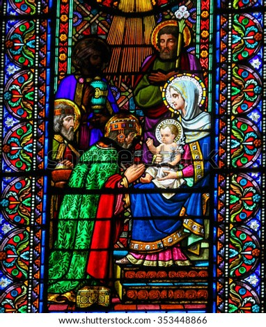 MONTSERRAT, SPAIN - JULY 17, 2014: Stained glass window depicting the Three Wise Men visiting Jesus, in the abbey of Santa Maria de Montserrat in Catalonia, Spain - stock photo