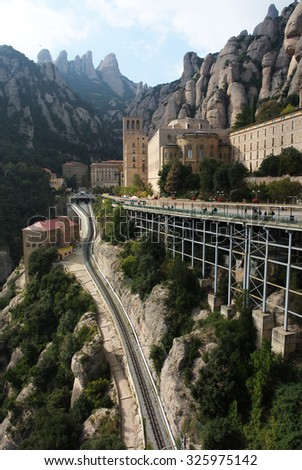 MONTSERRAT, SPAIN - OCTOBER 25, 2014: Every day, hundreds of people travel to the top of the mountain to visit Santa Maria de Montserrat abbey in Montserrat, Catalonia, Spain, Oct.25, 2014.