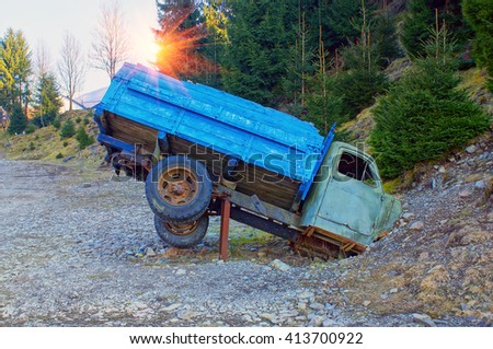 Monument in the mountains of the Ukrainian Carpathians is dedicated to the broken Soviet truck on a background of forest and mountains. It attracts tourists to the museum railway - stock photo