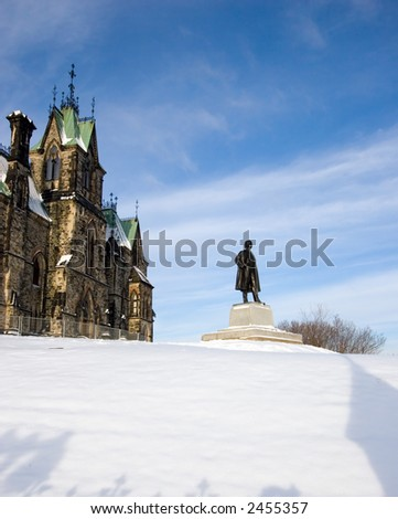 Monument Overlooking a Snowy Field at the House of Parliament, Ottawa, Canada - stock photo
