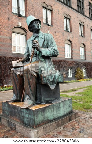 Monument to Hans Christian Andersen against Town Hall building in Copenhagen, Denmark. The monument was erected in 1954-61 - stock photo