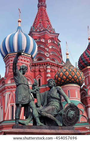 Monument to Minin and Pozharsky and Saint Basil Cathedral on the Red Square in Moscow - stock photo
