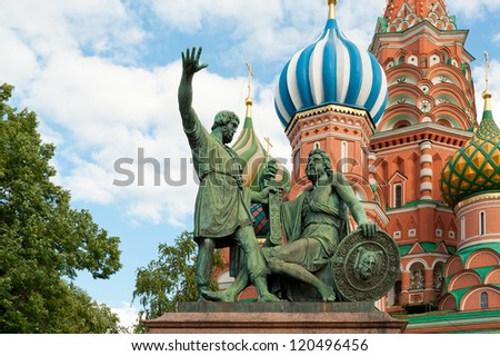 Monument to Minin and Pozharsky in front of St. Basil's Cathedral. Red Square, Moscow, Russia. - stock photo
