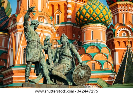 Monument to Minin and Pozharsky on the background of the Saint Basil's Cathedral in Red Square in Moscow, Russia. - stock photo