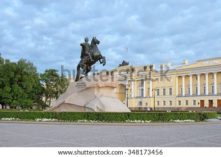 "Monument to Peter 1, ""the bronze horseman"" in front of the building of Senate and Synod during the white nights in St. Petersburg on a background of clouds"