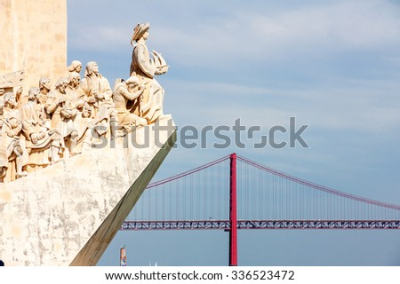 Monument To The Discoveries And April 25Th Bridge In Lisbon, Portugal - stock photo