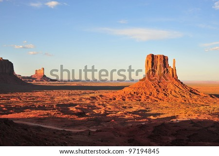 Monument Valley is a region of the Colorado Plateau characterized by a cluster of vast sandstone buttes - stock photo