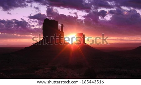 Monument Valley 01 Sunrise from Left & Right Mitten Butte Utah Arizona USA - stock photo