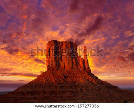 Monument Valley West Mitten at sunset colorful sky Utah - stock photo