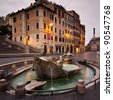 Monumental fountain in Spanish square, in the heart of Roma, at base of Spanish steps at dusk with nobody around - stock photo