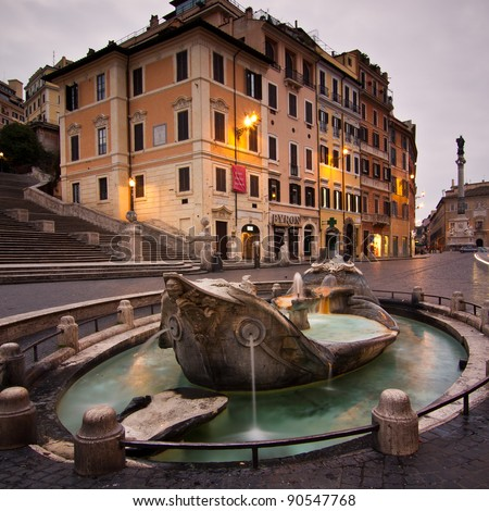 Monumental fountain in Spanish square, in the heart of Roma, at base of Spanish steps at dusk with nobody around