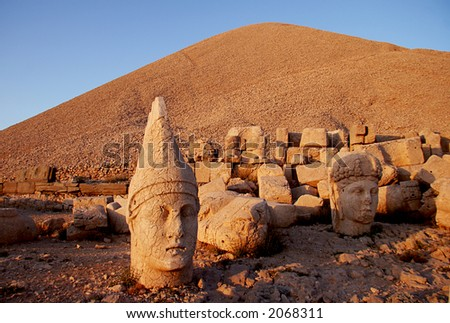 Monumental head of Apollo at sunset, Namrut Dagi, Turkey - stock photo