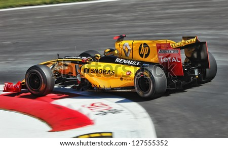 MONZA, ITALY - SEP 11 : Polish driver Robert Kubica in a Renault R30 races in the Italian Grand Prix, on Sep 11, 2010 in Monza, Italy - stock photo