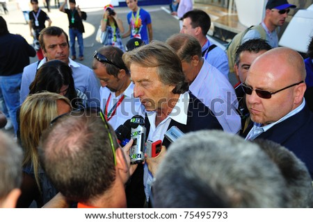 MONZA, ITALY - SEPTEMBER 11 : Chairman of Ferrari, Luca di Montezemolo is giving an interview during the Formula One 2010 at Monza circuit. September 11, 2010 in Monza, Italy - stock photo