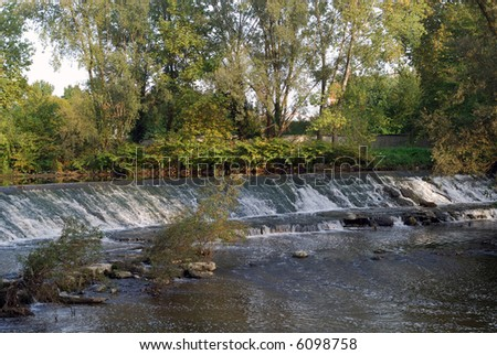 Monza Park (Lombardy, Italy) in autumn - Little waterfalls in the Lambro river