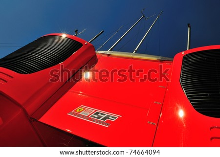 MONZA - SEPTEMBER 11: Motorhome from team Ferrari in the Paddock and the sun on circuit Monza, italy on september 11, 2010 in monza, italy, formula 1 - stock photo