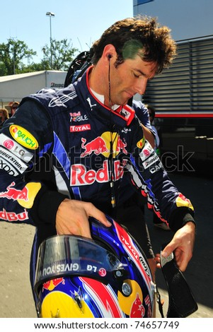 MONZA - SEPTEMBER 11: Red Bull Racing Team Driver, Mark Webber of Australia finished the practice on september 11, 2010 in monza, italy, formula 1 - stock photo