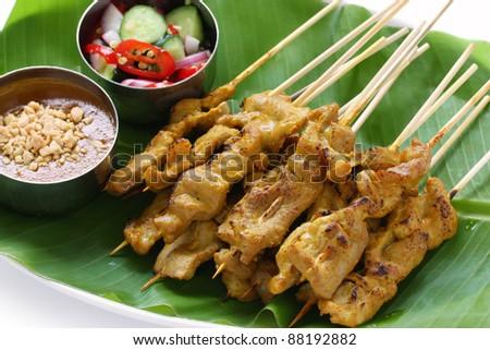 moo satay, pork satay, thai cuisine - stock photo